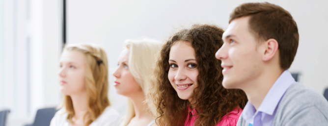 4 young adults in a classroom environment